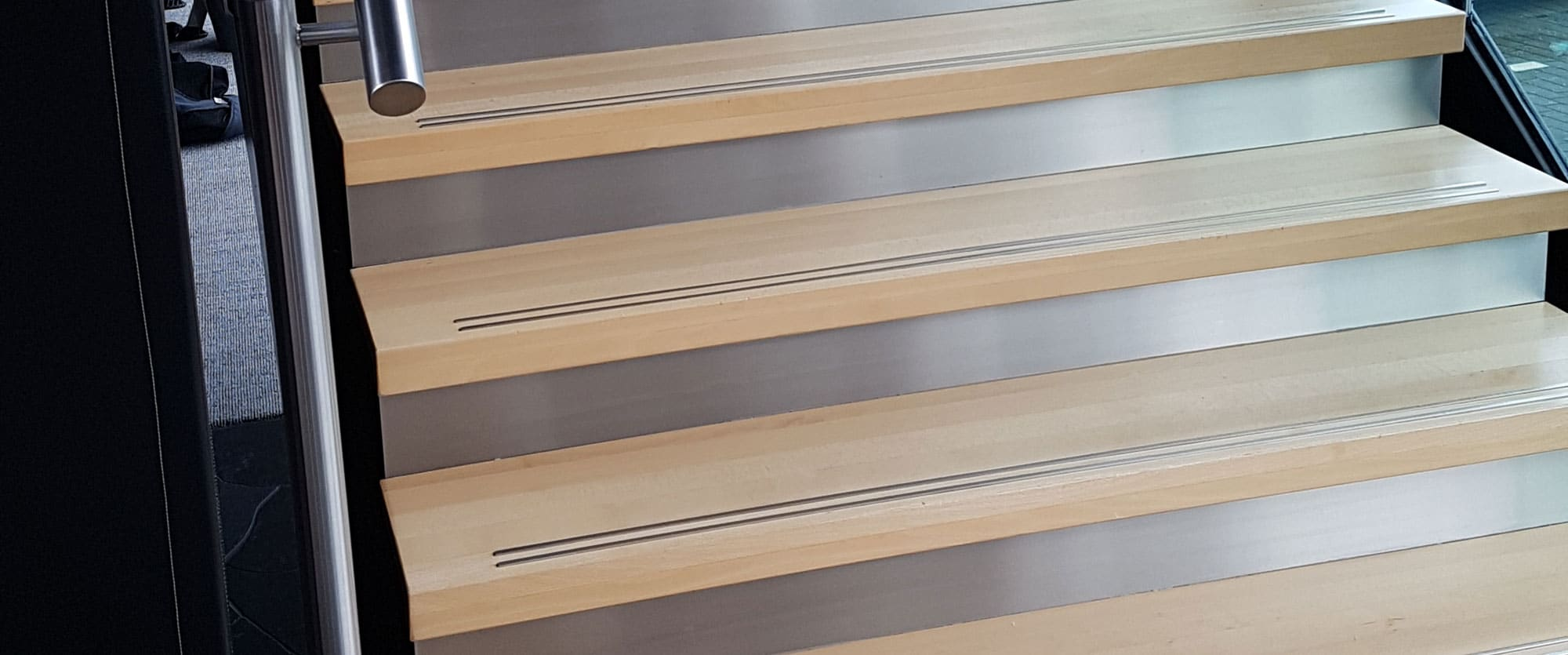 Two step anti-slip inserts per wooden stair in office